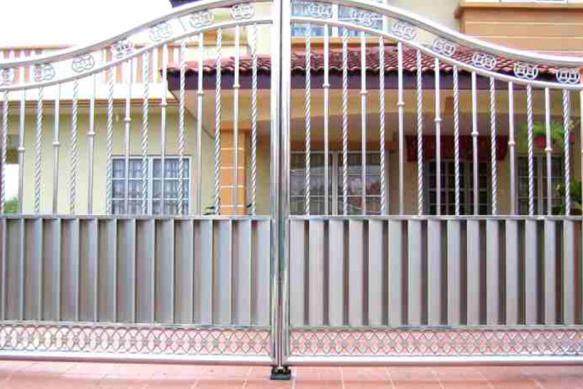 Beautifully designed steel gate in front the residential house